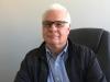 Karl Peters as Sr. Sales Engineer in the Industrial Optics Division.